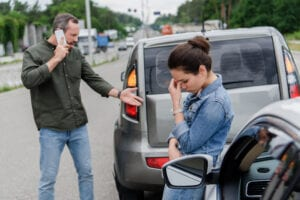 car accident upset man and woman insurance fraud fraud protection