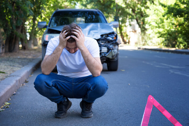 man stressed from accident